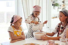 Children cooking in the kitchen Stock Images