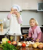 Children cooking in kitchen Royalty Free Stock Image