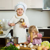 Children cooking in kitchen Royalty Free Stock Photo
