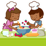 Children cooking in the kitchen. Vector Illustration of a little African boy and a little girl having fun and cooking together in the kitchen Stock Photo