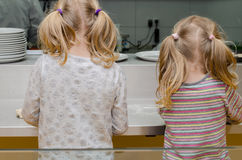 Children cooking rear view Royalty Free Stock Photography