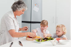 Children cooking with their grandmother Royalty Free Stock Photo