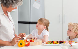 Children cooking with their grandmother Royalty Free Stock Images