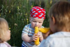 Children with corn Royalty Free Stock Photo