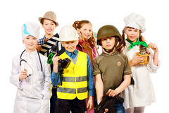 Children in costumes. A group of children dressed in costumes of different professions. Isolated over white Royalty Free Stock Photos