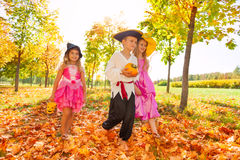 Children in costumes during Halloween, forest Stock Photography