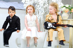 Children in costumes stars which sit on letters love Royalty Free Stock Images