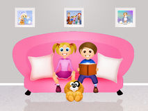 Children on the couch Royalty Free Stock Photo