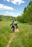 Children country biking. Two children on bicycles in the country Stock Photo