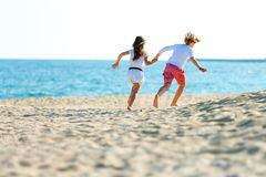 Children couple running on beach. Stock Photos