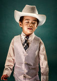 Children with cowboy fashion. Potrait of boy in the studio with cowboy theme royalty free stock photography