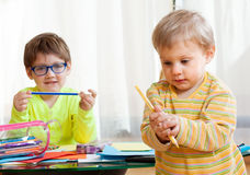Children  with crayons Royalty Free Stock Photography