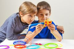 Children creating with 3d printing pen. New object Royalty Free Stock Photo