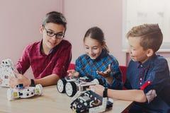 Stem education. Kids creating robots at school. Children creating robots at school, stem education, copy space. Early development, diy, innovation, modern royalty free stock photo