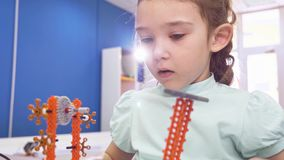 Children creating robots at school, stem education. Early development, diy, innovation, modern technology concept. Children creating robots at school, stem stock video