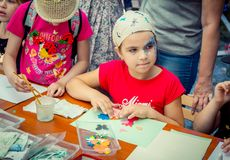 Children creative activity at charity Family festival. Zaporozhia/Ukraine- June 2, 2018: Charity Family festival –children and their parents stock image