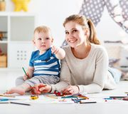 Children creativity. mother and baby son drawing together Royalty Free Stock Photo