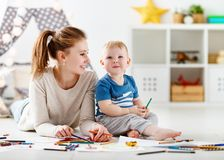 Children creativity. mother and baby son drawing together Stock Photo