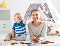 Children creativity. mother and baby son drawing together Royalty Free Stock Photos