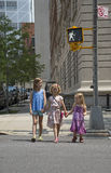 Children cross street at Walking man signal Stock Images