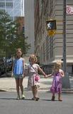 Children cross street at Walking man signal Stock Photography