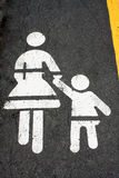 Children crossing the road sign isolated on road Stock Photo