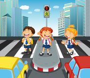 Children crossing the road on zebra crossing Royalty Free Stock Photos