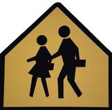 Children crossing sign. A sign marking a children's crossing area royalty free stock photography