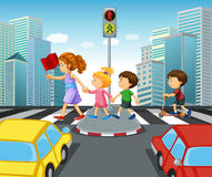 Children crossing street in city Stock Image