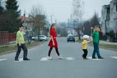 Children crossing street on crosswalk. Photo of children crossing street on the crosswalk Royalty Free Stock Image