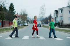 Children crossing street on crosswalk Royalty Free Stock Images