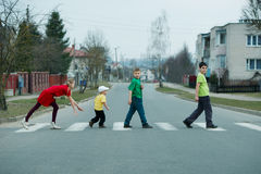 Children crossing street on crosswalk Stock Image