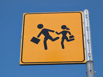 Children crossing street sign. Children crossing street road sign back to school image Royalty Free Stock Photography