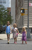 Children crossing street at walk signal Stock Photos