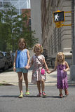 Children crossing street at walk signal Stock Photography