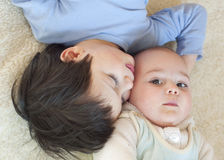Children cuddling Royalty Free Stock Images