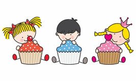 Children with cupcakes Stock Photos