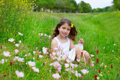 Children cute girl on spring meadow with poppy flowers Stock Photos