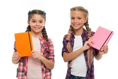Children cute girls hold notepads or diaries isolated on white background. Note secrets down in your cute girly diary. Journal. Diary writing for children royalty free stock photos