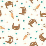 Children cute seamless pattern with rabbits and carrots Stock Photography