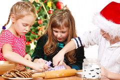 Children cutting Christmas cookies Royalty Free Stock Photos
