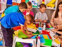 Children cutting paper in class. Development social lerning in school. Royalty Free Stock Photo