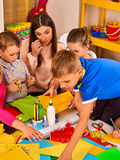 Children cutting paper in class. Development social lerning in school. Royalty Free Stock Photos