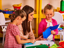 Children cutting paper in class. Development social lerning in school. Stock Image