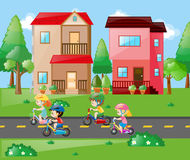 Children cycling in the neighborhood Royalty Free Stock Photo
