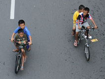 Children cycling in solo car free day a week surakarta Stock Images