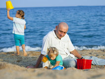 Children with Dad on  beach Stock Photo