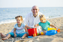 Children with Dad on  beach Stock Photos
