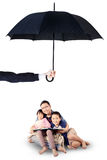 Children and dad reading book under umbrella Royalty Free Stock Photo