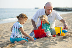 Children with Dad    at summer day. Stock Photo